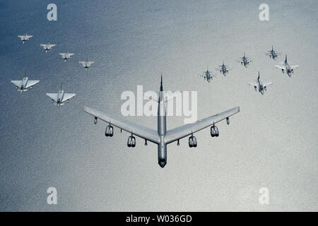 A United States Air Force B-52 Stratofortress leads a formation of aircraft including two Polish air force F-16 Fighting Falcons, four U.S. Air Force F-16 Fighting Falcons, two German Eurofighter Typhoons and four Swedish Gripens over the Baltic Sea, on June 9, 2016. Photo BY Senior Airman Erin Babis/U.S. Air Force/UPI - Stock Photo