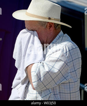 A man wipes his face as the temperatures heat up the crowd before the arrival of Donald Trump at a rally at Fountain Park in Fountain Hills, Arizona, March 19,  2016. Temperatures in the Phoenix area are expected to reach the 90's today. Photo by Art Foxall/UPI - Stock Photo
