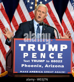 Donald Trump's running mate Mike Pence talks to the crowd before Trump takes the stage to tell the crowd about his ten point immigration policy at the Phoenix Convention Center in Phoenix, Arizona, August 31, 2016.  Photo by Art Foxall/UPI - Stock Photo