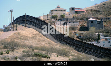 Barbed wire has been placed on top and side of the fence along the United States-Mexico border, shown here, heading East from Nogales, Arizona on February 8, 2019. The Arizona city has ordered Federal Officials to remove the barbed wire. Photo by Art Foxall/UPI - Stock Photo