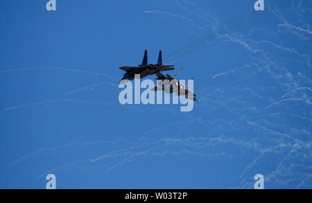 F-15C Eagles from the 123rd Fighter Squadron Oregon National Guard fly before a NASCAR race in Sonoma, California - Stock Photo