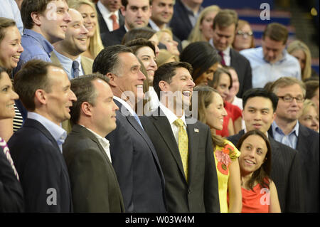Republican presidential candidate Mitt Romney (L) and Vice-President nominee Rep. Paul Ryan pose with the Romney campaign staff for an official portrait in front of the podium at the 2012 Republican National Convention at the Tampa Bay Times Forum in Tampa on August 30, 2012.      UPI/Mike Theiler