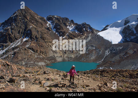 Trekking above Laguna Congelada along the Cordillera Real Traverse, Bolivia - Stock Photo