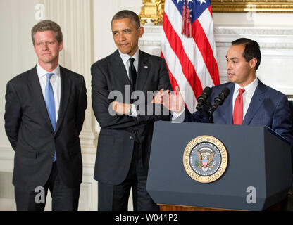United States President Barack Obama, center, announces his  nomination of current Housing and Urban Development (HUD) Secretary Shaun Donovan, left, as Office of Management and Budget (OMB) Director and his nomination of San Antonio Mayor Julián Castro, right, to replace him at HUD in the State Dining Room of the White House in Washington, D.C. on Friday, May 23, 2014.Credit: Ron Sachs / Pool via CNP /MediaPunch - Stock Photo