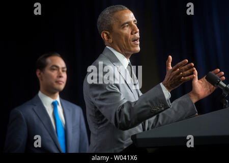 United States President Barack Obama, right, speaks to employees at the Department of Housing and Urban Development with Julian Castro, Secretary of U.S. Housing and Urban Development (HUD), in Washington, D.C., U.S., on Thursday, July 31, 2014. Castro, the former San Antonio, Texas mayor, was sworn in this week and will begin his duties on Monday, Aug. 4. Credit: Andrew Harrer / Pool via CNP /MediaPunch - Stock Photo