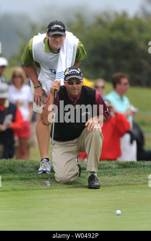 Rocco Mediate and his caddie Matt Achatz line up a putt on the 5th green during the second round of the US Open at Torrey Pines Golf Course in San Diego on June 13, 2008.  (UPI Photo/Kevin Dietsch) - Stock Photo