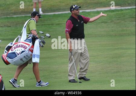 Rocco Mediate, joined by his caddie Matt Achatz, reacts after a hit on the 5th fairway during the second round of the US Open at Torrey Pines Golf Course in San Diego on June 13, 2008.  (UPI Photo/Kevin Dietsch) - Stock Photo