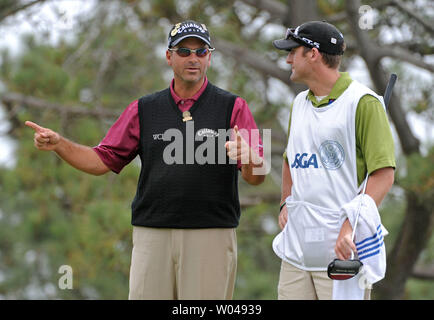 Rocco Mediate talks to his caddie Matt Achatz after he birdied the 4th hole during the second round of the US Open at Torrey Pines Golf Course in San Diego on June 13, 2008.  (UPI Photo/Kevin Dietsch) - Stock Photo