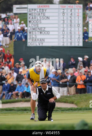 Rocco Mediate and his caddie Matt Achatz line up a birdie putt on the 5th green during the third round of the US Open at Torrey Pines Golf Course in San Diego on June 14, 2008.  (UPI Photo/Kevin Dietsch) - Stock Photo