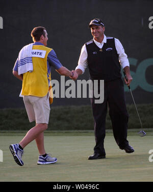 Rocco Mediate shakes hands with his caddie Matt Achatz after finishing their round on the third day of the US Open at Torrey Pines Golf Course in San Diego on June 14, 2008.  (UPI Photo/Kevin Dietsch) - Stock Photo