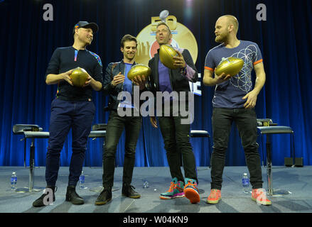 Member of the band Coldplay, from left to right, John Buckland, Guy Berryman, Chris Martin and Will Champion, pose during the Super Bowl 50 half time show press conference in San Francisco on February 4, 2016. The Denver Broncos will play the Carolina Panthers in Super Bowl 50 on Sunday, February 7. Photo by Kevin Dietsch/UPI - Stock Photo