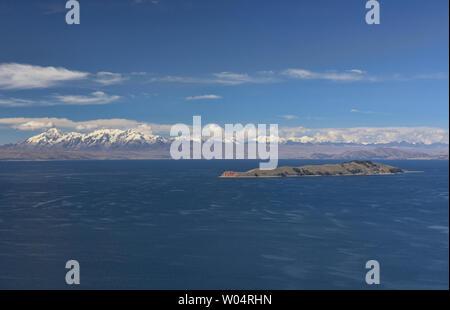 View of the entire Cordillera Real and Isla de la Luna across Lake Titicaca, Isla del Sol, Bolivia - Stock Photo