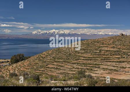 View of the entire Cordillera Real and Cerro Palla Khasa on Isla del Sol, Lake Titicaca, Bolivia - Stock Photo
