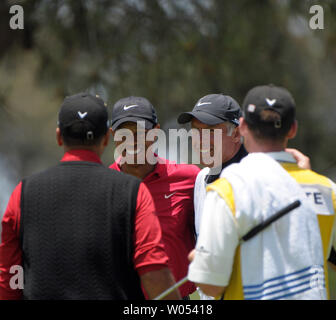 Tiger Woods with caddie Steve Williams (Center) are congratulated by Rocco Mediate (L) and caddie Matt Achatz on winning the 108th US Open at Torrey Pines Golf Course in San Diego on June 16, 2008. (UPI Photo/Earl S. Cryer) - Stock Photo