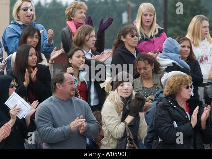 Friends and family members clap during welcome home ceremonies for the 3rd Brigade, 2nd Infantry Division at Fort Lewis in Tacoma, Washington on October 11, 2007. Soldiers from the 3rd Stryker Brigade were deployed in Iraq from June 2006 to September 2007. (UPI Photo/Jim Bryant) - Stock Photo