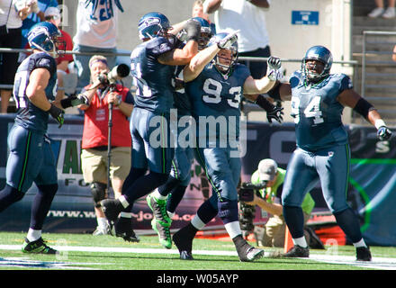 Seattle Seahawks defenders celebrate with defensive tackle Craig Terrell (93) in the end zone after Terrell scored on a 10-yard fumble return for a touchdown in the first  quarter at Qwest Field in Seattle on September14, 2008. (UPI Photo/Jim Bryant) - Stock Photo
