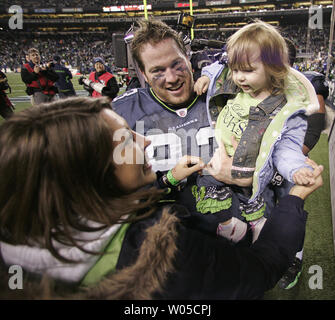 Seattle Seahawks defensive tackle Craig Terrill celebrates with his family their 41-36 win over the defending Super Bowl Champion New Orleans Saints in the NFC's wild-card playoff game on Saturday January 8, 2011 at Qwest Field in Seattle.  (UPI /Jim Bryant) - Stock Photo