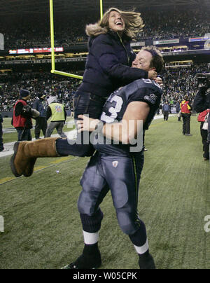 Seattle Seahawks defensive tackle Craig Terrill celebrates with his wife after their 41-36 win over the defending Super Bowl Champion New Orleans Saints in the NFC's wild-card playoff game on Saturday January 8, 2011 at Qwest Field in Seattle.    (UPI /Jim Bryant) - Stock Photo