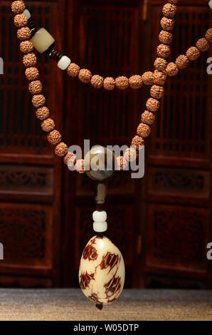 Ivory fruit pendant King Kong Bodhi necklace - Stock Photo