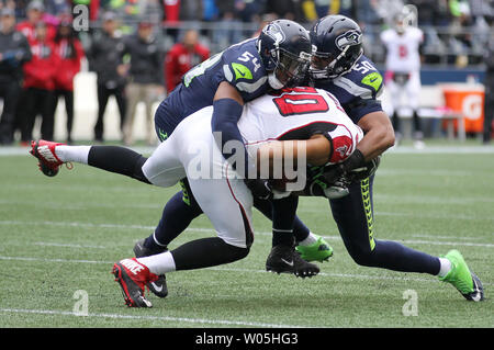 Seattle Seahawks middle linebacker Bobby Wagner (54) and Seattle Seahawks outside linebacker K.J. Wright (50) team up to bring down Atlanta Falcons tight end Levine Toilolo (80) during the fourth quarter at CenturyLink Field in Seattle, Washington on October 16, 2016. The Seahawks beat the Falcons 26-24.    Photo by Jim Bryant/UPI - Stock Photo