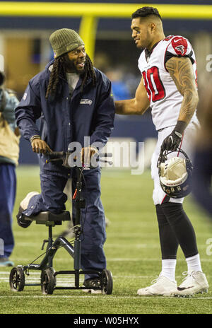 Atlanta Falcons tight end Levine Toilolo (80) pats Seattle Seahawks cornerback Richard Sherman on the back following their game at CenturyLink Field in Seattle, Washington on November 20, 2017. Sherman was lost for the season to a torn Achilles. The Atlanta Falcons beat the Seattle Seahawks 34-31 in Seattle.  Photo by Jim Bryant/UPI - Stock Photo