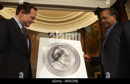 St. Louis Mayor Francis Slay (L) and Harold Crumpton, president of the St. Louis NAACP, talk about details of a ceremony that will celebrate the life of  'The Mother of the Modern Day Civil Rights Movement,' Rosa Parks, in St. Louis on November 28, 2005. The ceremony will be held on  December 1, the same day Parks was arrested for not giving up her seat on a city bus to a white man in Montgomery, AL in 1955. (UPI Photo/Bill Greenblatt) - Stock Photo