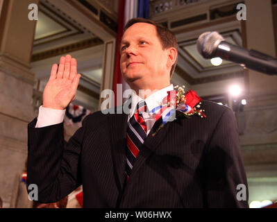 St. Louis Mayor Francis Slay takes the oath of office during his inauguration ceremony in the rotunda of City Hall in St. Louis on April 21, 2009. Slay joins a group of three others that have served three terms as Mayor of St. Louis. (UPI Photo/Bill Greenblatt) - Stock Photo