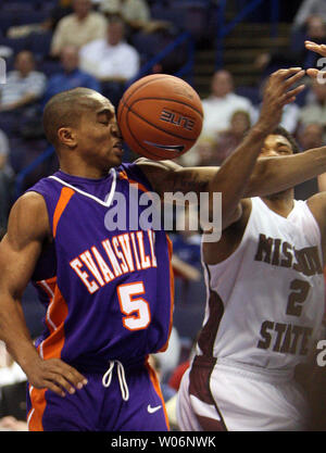 Evansville Purple Aces Troy Taylor (5) and Missouri State Bears Nafis Ricks (2) battle for the rebound in the first half of the Missouri Valley Conference Tournament at the Scottrade Center in St. Louis on March 4, 2010.      UPI/Bill Greenblatt - Stock Photo