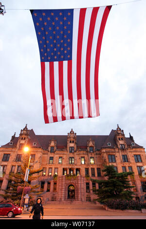 St. Louis firefighter yells adjustments during the raising of an oversized American flag in front of City Hall before the start of the Third Annual Fallen Firefighters Candlelight Remembrance Vigil in St. Louis on September 8, 2011. The solemn ceremony, which reads the names of nearly 200 area firefighters killed in the line of duty,  kicks off a weekend of activities for St. Louis firefighters.     UPI/Bill Greenblatt - Stock Photo