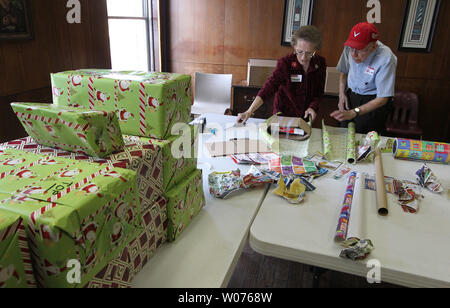 Volunteers wrap Christmas presents for the children of residents of the Salvation Army Harbor Light in St. Louis on November 22, 2012. The presents will ensure the children of homeless men will have gifts to open on Christmas Day.   UPI/Bill Greenblatt