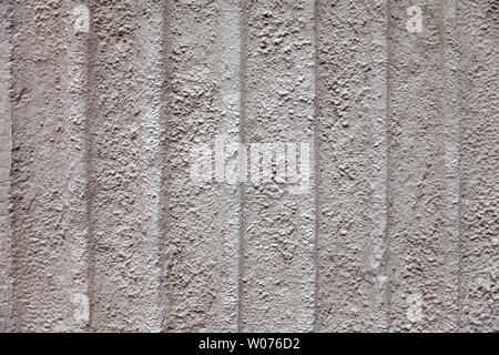 Gray dull background with a rough stone texture with vertical stripes of beige color on the wall of an old antique building. Substrate under the text - Stock Photo