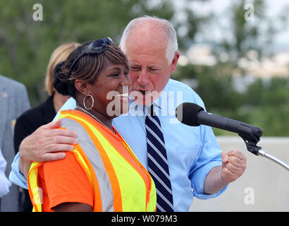 Illinois Governor Pat Quinn joins Illinois Department Transportation worker Theresa Foote as they talk about the diverse workforce that have worked on Mississippi River Bridge in Brooklyn, Illinois on July 15, 2013. The bridge will be named the Stan Musial Veterans Bridge, will connect Illinois to Missouri and has created 3,400 jobs. The bridge should be open by March 2014.    UPI/Bill Greenblatt - Stock Photo