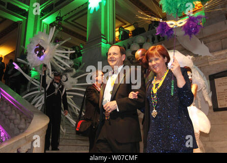 St. Louis Mayor Francis Slay and wife Kim make their way down the marble stairs as they are introduced during the Mayor's Mardi Gras Ball in City Hall in St. Louis on February 28, 2014.   UPI/Bill Greenblatt - Stock Photo