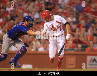 New York Mets catcher Anthony Recker reaches out to tag St. Louis Cardinals Peter Bourjos after striking out in the fifth inning at Busch Stadium in St. Louis on June 17, 2014.  UPI/Bill Greenblatt - Stock Photo