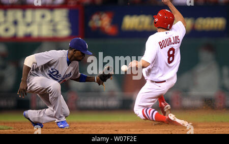 St. Louis Cardinals Peter Bourjos slides safely into second base, knocking the baseball free from the glove of Los Ageles Dodgers Juan Uribe in the eighth inning at Busch Stadium in St. Louis on July 20, 2014.   UPI/Bill Greenblatt - Stock Photo