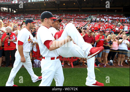 St. Louis Cardinals pitcher Shelby MIller picks up fellow pitcher Sam Freeman as team members walk around the field on Photo Day before a game against the Los Angeles Dodgers at Busch Stadium in St. Louis on July 20, 2014.   UPI/Bill Greenblatt - Stock Photo