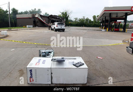 St. Louis County Police stand guard over a QuickTrip Gas staton that was burned, while a ATM machine lays in the parking lot following a night of looting, rioting and arsons in Ferguson, Missouri on August 11, 2014. People are upset because of the Ferguson Police shooting and death of an unarmed black teenager Michael Brown on August 9, 2014. In all about 20 businesses sustained damage after a candlelight vigil turned violent.   UPI/Bill Greenblatt