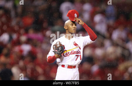 St. Louis Cardinals pitcher Sam Freman agjusts his cap after has problems with the San Diego Padres in the eighth inning at Busch Stadium in St. Louis on August 15, 2014. St. Louis won the gme 4-2. UPI/Bill Greenblatt - Stock Photo