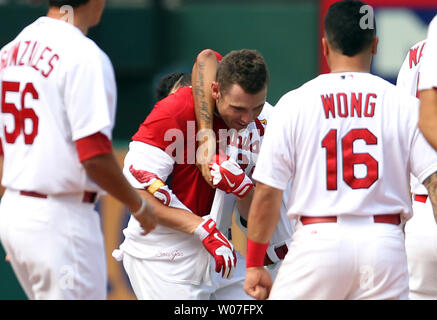 St. Louis Cardinals Peter Bourjos is mobbed by teammates after hitting the game winning RBI in the ninth inning to defeat the Pittsburgh Pirates 1-0 at Busch Stadium in St. Louis on September 3, 2014. UPI/Bill Greenblatt - Stock Photo