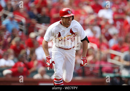 St. Louis Cardinals Peter Bourjos smiles as he runs to first base after hitting the game winning RBI in the ninth inning to defeat the Pittsburgh Pirates 1-0 at Busch Stadium in St. Louis on September 3, 2014. UPI/Bill Greenblatt - Stock Photo
