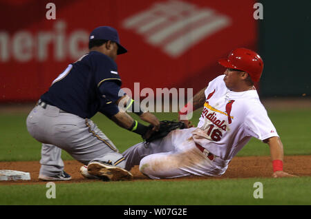 St. Louis Cardinals Kolten Wong is tagged out as he tries to steal second base by MIlwaukee Brewers Jean Segura in the second inning at Busch Stadium in St. Louis on September 16, 2014. UPI/Bill Greenblatt - Stock Photo
