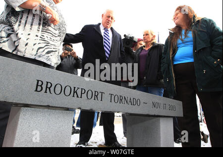 Illinois Governor Pat Quinn joins the relatives of those killed in the Brookport, Illinois tornado of 2013, during the unveiling of a stone bench dedicated to their honor, in Brookport, Illinois on November 17, 2014. On November 17, 2013, intense storms and tornadoes swept through southern Illinois. Three died in the storms rated by the National Weather Service as a EF-4, with wind speeds of 170 mph to 190 mph.  Brookport, Illinois, is located across the Ohio River from Paducah, Kentucky.  UPI/Bill Greenblatt - Stock Photo
