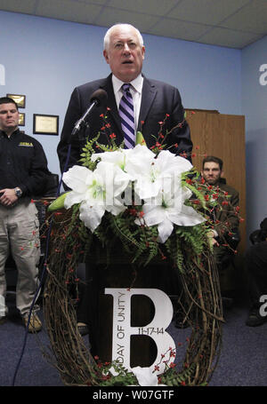 Illinois Governor Pat Quinn joins the relatives of those killed in the Brookport, Illinois tornado of 2013, during a ceremony of 'A Day of Unity' in Brookport, Illinois on November 17, 2014. On November 17, 2013, intense storms and tornadoes swept through southern Illinois. Three died in the storms rated by the National Weather Service as a EF-4, with wind speeds of 170 mph to 190 mph.  Brookport, Illinois, is located across the Ohio River from Paducah, Kentucky.  UPI/Bill Greenblatt - Stock Photo
