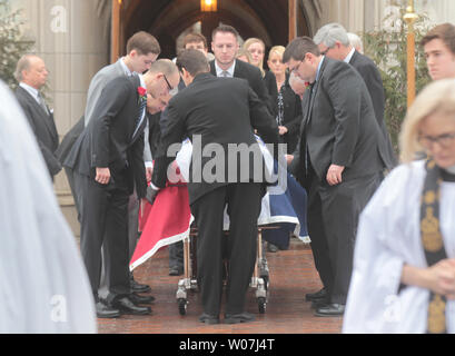 A casket draped with the Missouri state flag, containing the remains of Missouri Auditor Tom Schweich is moved from the Church of St. Michael and St. George in Clayton, Missouri on March 3, 2015. The 54-year-old Republican auditor fatally shot himself at his home on February 26. Scweich, a candidate for Missouri Governor was the target of a radio ad that ridiculed his appearancence and accused him of being a pawn for the Democrats. Photo by Bill Greenblatt/UPI.. - Stock Photo