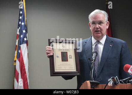 Missouri Governor Jay Nixon dispalys the Flag of Freedom award, he is presenting to the General Motors Assembly Plant in Wentzville, Missouri on March 9, 2015. The award recognizes the company's commitment to hiring veterans through Missouri's Show-Me Heroes program.The Flag of Freedom Award, which consists of a plaque featuring an American flag patch from the combat uniform of a member of the Missouri National Guard worn while that citizen-Soldier or Airman was deployed in Iraq or Afghanistan. Photo by Bill Greenblatt/UPI - Stock Photo
