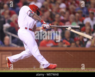 St. Louis Cardinals Kolten Wong breaks his bat as he swings in the fourth inning against the New York Mets at Busch Stadium in St. Louis on August 23, 2016.    Photo by Bill Greenblatt/UPI - Stock Photo