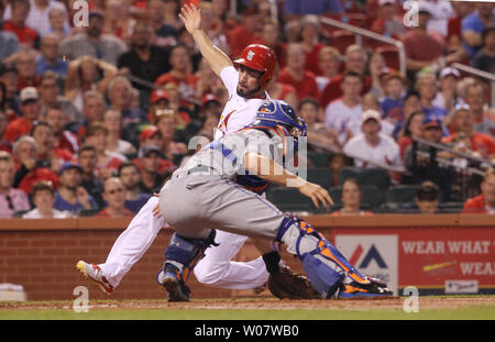 St. Louis Cardinals Randal Grichuk is tagged out at homeplate by New York Mets catcher Travis D'Arnaud in the second inning at Busch Stadium in St. Louis on August 24, 2016.    Photo by Bill Greenblatt/UPI - Stock Photo