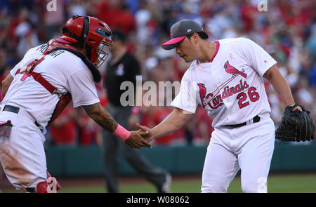 St. Louis Cardinals pitcher Seung Hwan Oh and catcher Yadier Molina celebrate the third out and a 5-3 victory over the Chicago Cubs at Busch Stadium in St. Louis on May 13, 2017. Photo by Bill Greenblatt/UPI