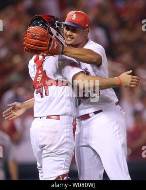 St. Louis Cardinals pitcher Sam Tuivailala and catcher Eric Fryer celebrate the third out and a 14-6 win over the Miami Marlins at Busch Stadum in St. Louis on July 3, 2017. Photo by Bill Greenblatt/UPI - Stock Photo