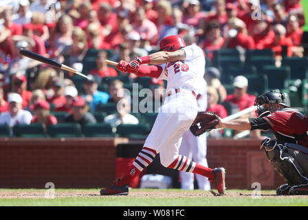 St. Louis Cardinals Tommy Pham swings breaking his bat in the seventh inning against the Arizona Diamondbacks at Busch Stadium in St. Louis on July 30, 2017.  Photo by Bill Greenblatt/UPI - Stock Photo